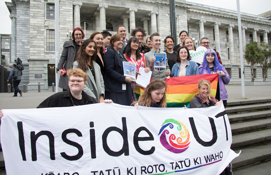 InsideOUT representatives holding our banner on the steps of parliament with MPS and Young Labour/Young Greens handing over petitions to ban conversion practices